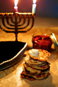 Hanukkah candles and latkes